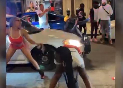 St. Louis: Street Mob Stops Police Car — Twerks in the Street — Dance on Its Roof (VIDEO)