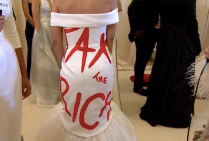 AOC Wears a High End Designer 'Tax The Rich' Dress to $30,000 Per Ticket Met Gala