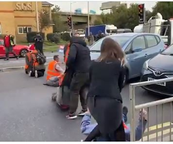 DRIVERS FIGHT BACK: Outraged UK Drives Drag Eco-Mob Protesters from Street Who Were Blocking Traffic (VIDEO)